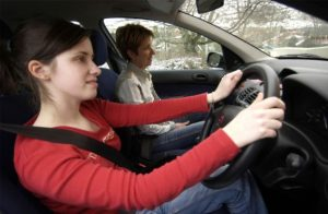 AMNY4K Young driver with driving instructor